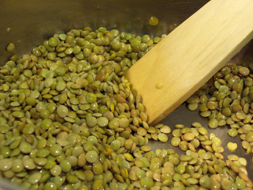 Dry lentils roasting for a moment in oil.
