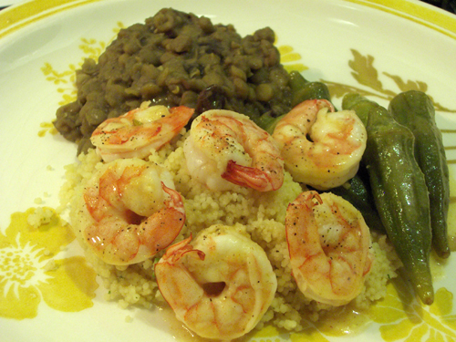 Thick curried lentils as a side dish for pineapple shrimp and okra, over couscous