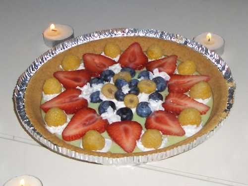 "Key lime birthday pie covered in ""exotic"" fruits"
