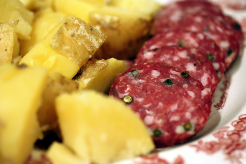 Potato and hard sausage for smothering with raclette cheese