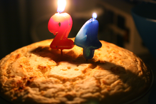 "Biscuit-top chicken pot pie casserole with ""24"" birthday candles lit on top."