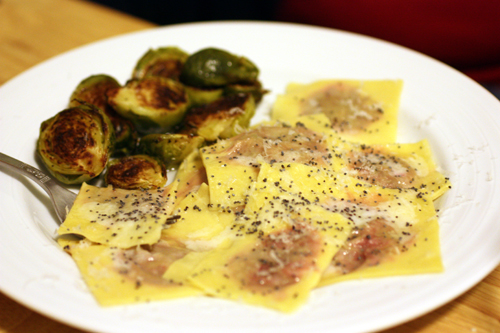 Beet and ricotta filled ravioli with brussels sprouts on the side