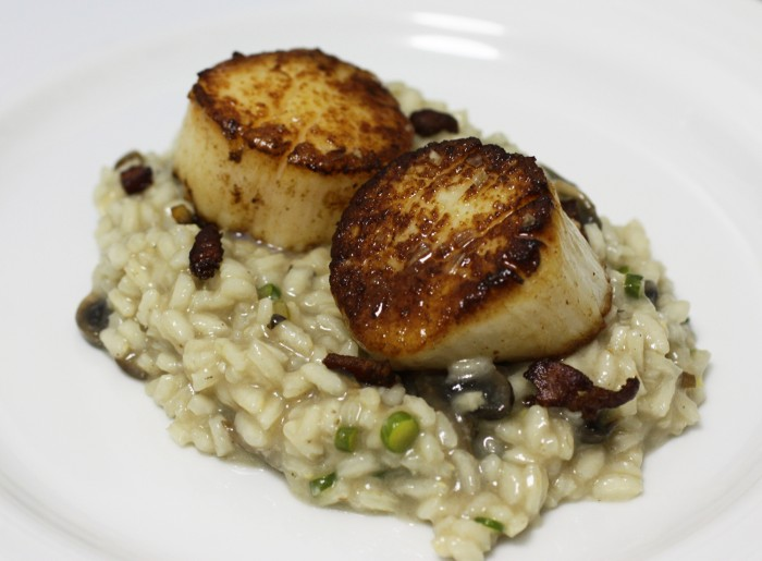 Seared sea scallops over mushroom and garlic scape risotto